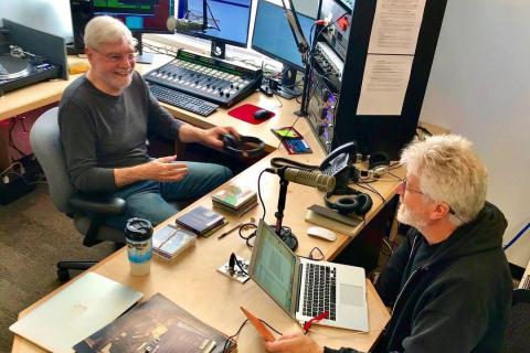 WTJU personalities Dave Rogers and Rus Perry discuss programming | COURTESY WTJU