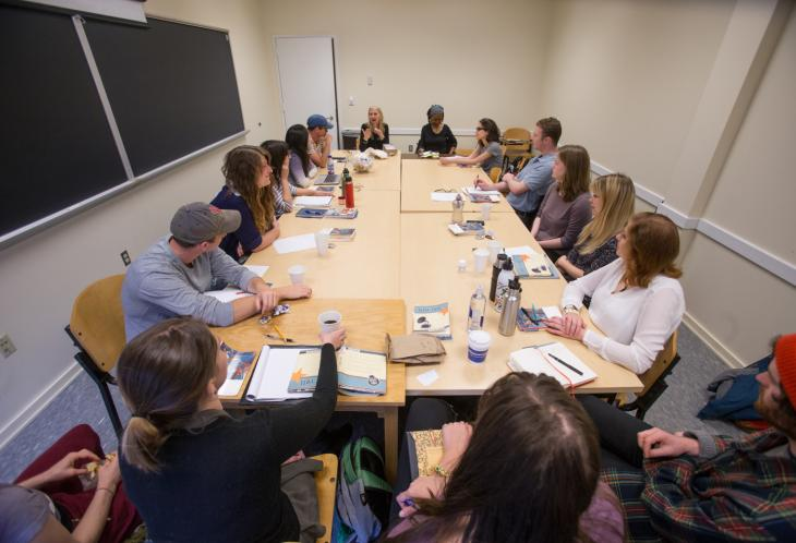 Students in writing seminar sitting around table